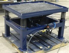 Pneumatic Drive Hopper Top Vibrating Table with removable screen top.