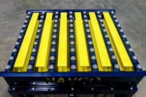 Custom grid top vibrating table with integrated ball transfer.